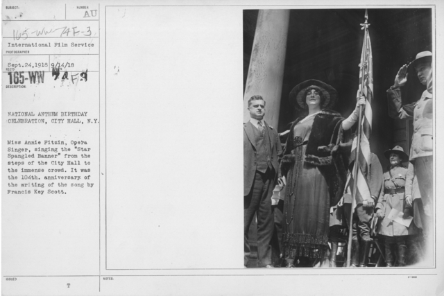 """Ceremonies - Liberations - National Anthem Day - National Anthem Birthday Celebration, City Hall, N.Y. City. Miss Annie Fitzin, Opera Singer, singing the """"Star Spangled Banner"""" from the steps of the City Hall to the immense crowd. It was the 104th anniversary of the writing of the son by Francis Key Scott"""