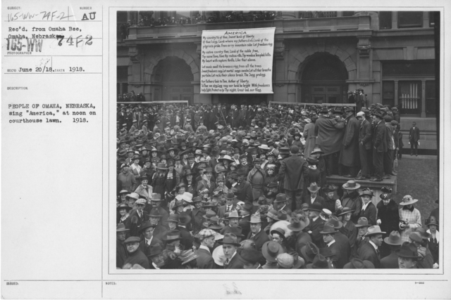 """Ceremonies - Liberations - National Anthem Day - People of Omaha, Nebraska, sing """"America,"""" at noon on courthouse lawn, 1918"""