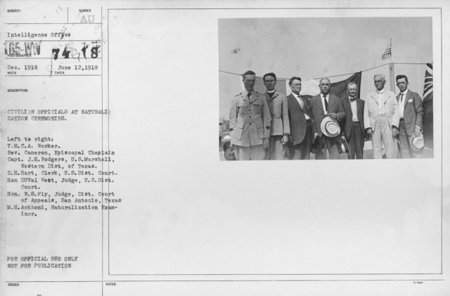Ceremonies - Liberations - Naturalization Ceremonies - Civilian officials at naturalization ceremonies. Left to right: Y.M.C.A. Worker. Rev. Cameron, Episcopal Chaplain; Capt. J.H. Rodgers, U.S. Marshall, Western Dist., of Texas; D.H. Hart, Clerk, U.S. Dist. Court; Hon DuVal West, Judge, U.S. Dist. Court; Hon. W.S. Fly, Judge, Dist. Court of Appeals, San Antonio, Texas; M.H. Anthoni, Naturalization Examiner