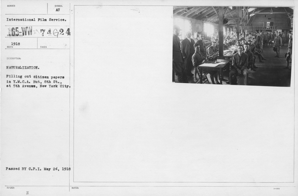 Ceremonies - Liberations - Naturalization Ceremonies - Naturalization. Filling out citizen papers in Y.M.C.A. Hut, 8th St., and 5th Avenue, New York City