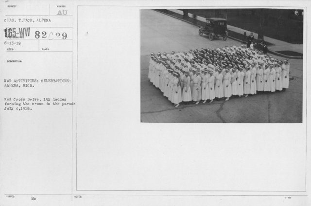 Ceremonies - Michigan thru New Jersey - War activities: Celebrations: Alpena, Mich. Red Cross Drive. 192 ladies forming the cross in the parade July 4, 1918