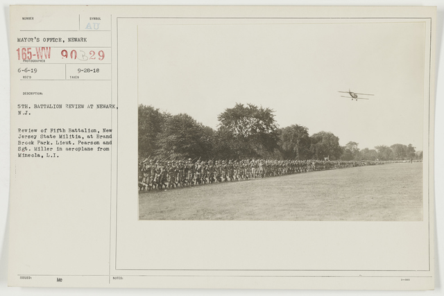 Ceremonies - Miscellaneous Reviews and Camp Scenes - 5th Battalion review at Newark, New Jersey.  Review of Fifth Battalion, New Jersey State Militia, at Brand Brook Park.  Lieutenant Pearson and Sergeant. Miller in aeroplane from Mineola, Long Island