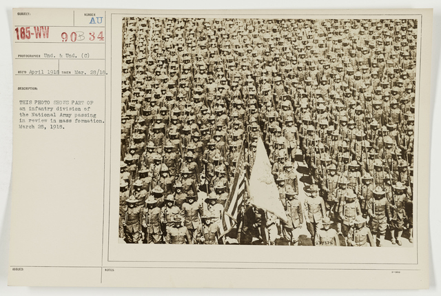 Ceremonies - Miscellaneous Reviews and Camp Scenes - This photo shows part of an infantry division of the National Army passing in review in mass formation.  March 28, 1918
