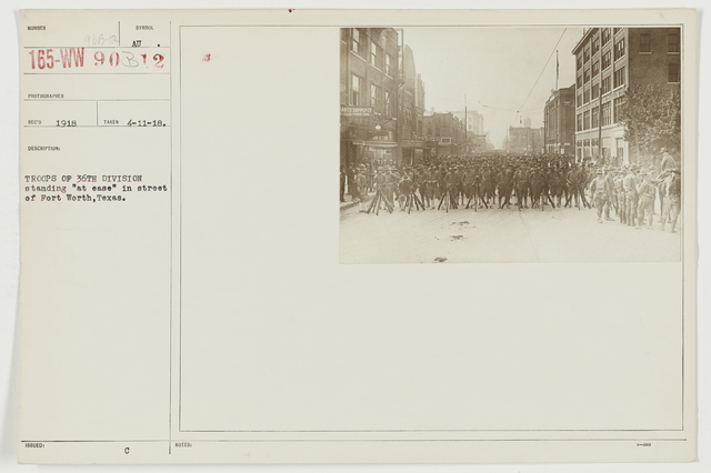 """Ceremonies - Miscellaneous Reviews and Camp Scenes - Troops of 36th Division standing """"at east"""" in street of Fort Worth, Texas"""