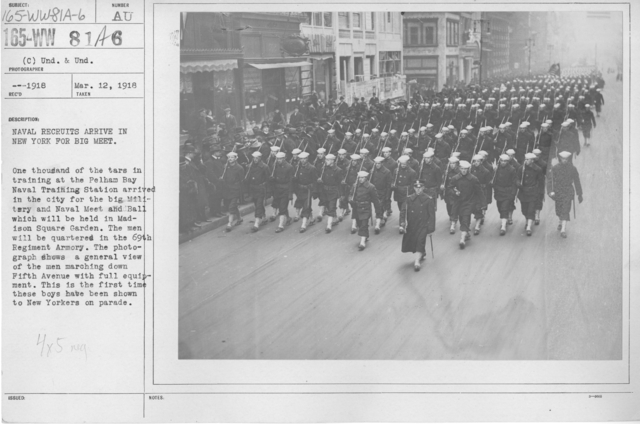 Ceremonies - Navy & Marines - Naval recruits arrive in New York for Big Meet. One thousand of the tars in trianing at the Pelham Bay Naval Training Station arrived in the city for the big Military and Naval Meet and Ball which will be held in Madison Square Garden. The men will be quartered in the 69th Regiment Armory. The photograph shows a general view of the men marching down Fifth Avenue with full equipment. This is the first time these boys have been shown to New Yorkers on parade