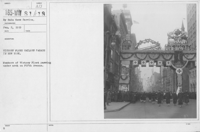 Ceremonies - Navy & Marines - Victory Fleet Sailors parade in New York. Members of Victory Fleet passing under arch on Fifth Avenue