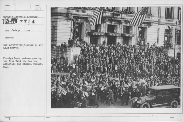 Ceremonies - New Jersey (Ships on the Hudson River) - War activities, parades to aid loan drives. Foreign born workmen passing the City Hall the day the armistice was signed. Newark, N.J