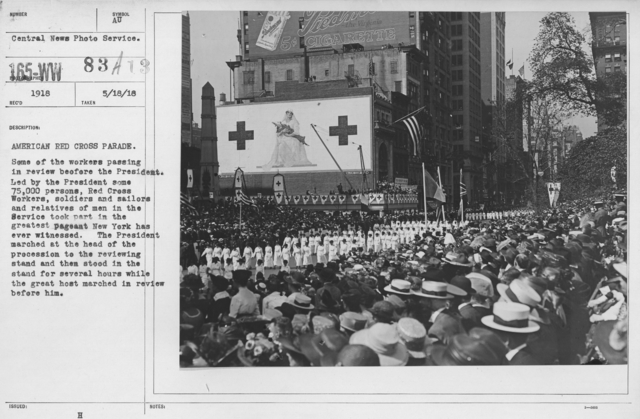 Ceremonies - New York - American Red Cross parade. Some of the workers passing in review before the President. Led by the President some 75,000 persons, Red Cross workers, soldiers and sailors and relatives of men in the Service took part in the greatest pageant New York has ever witnessed. The President marched at the head of the procession to the reviewing stand then stood in the stand for several hours while the great host marched in review before him