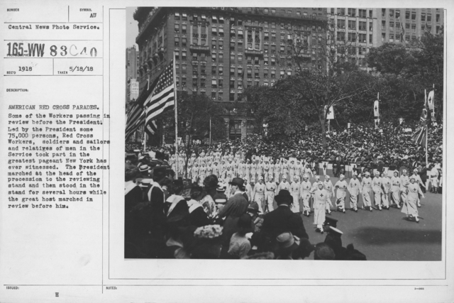 Ceremonies - New York - American Red Cross parades. Some of the workers passing in review before the President. Led by the President some 75,000 persons, Red Cross Workers, soldiers and sailors, and relatives of men in the Service took part in the greatest pageant New York has ever witnessed. The President marched at the head of the procession to the reviewing stand and then stood in the stand for several hours while the great host marched in review before him
