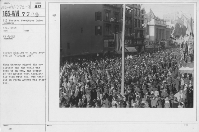"""Ceremonies - New York City - Crowds surging up Fifth Avenue on """"Victory Day."""" When Germany signed the armistice and the world war came to an end, the people of the nation went absolutely wild with joy. The traffic on Fifth Avenue was stopped"""