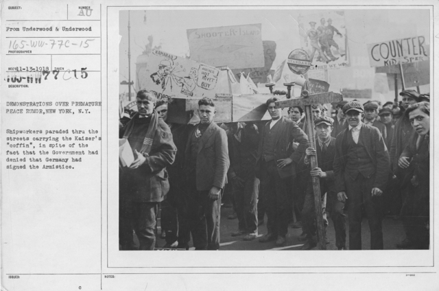 """Ceremonies - New York City - Demonstrations over premature peace rumor, New York, N.Y. Shipworkers paraded through the streets carrying the Kaiser's """"coffin"""", in spite of the fact that the Government had denied that Germany had signed the Armistice"""