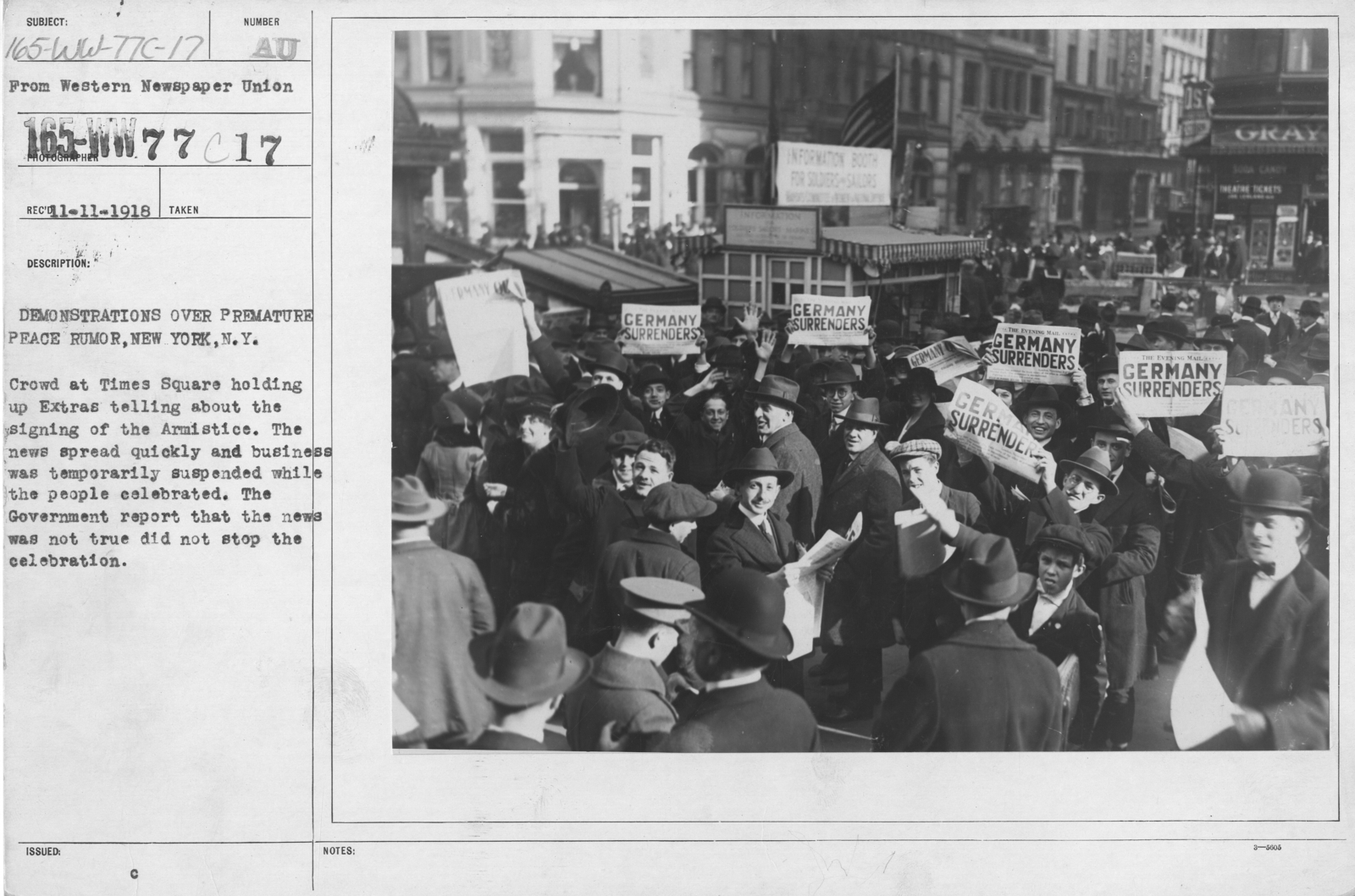 Ceremonies - New York City - Demonstrations over premature peace rumor, New York, N.Y. Crowd at Times Square holding up Extras telling about the signing of the Armistice. The news spread quickly and business was temporarily suspended while the people celebrated. The Government report that the news was not true did not stop the celebration