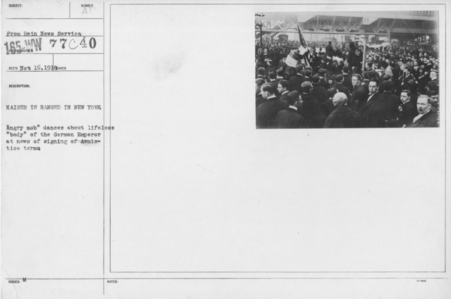 """Ceremonies - New York City - Kaiser is hanged in New York. """"Angry mob"""" dances about lifeless """"body"""" of the German Emperor at news of signing of Armistice terms"""