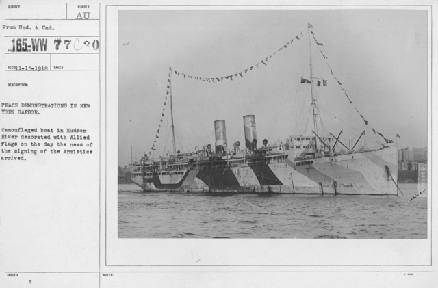 Ceremonies - New York City - Peace demonstrations in New York Harbor. Camouflaged boat in Hudson River decorated with Allied flags on the day the news of the signing of the Armistice arrived
