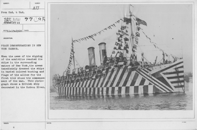 Ceremonies - New York City - Peace demonstrations in New York Harbor. When the the news of the signing of the armistice reached the ships in the surrounding waters of New York, the crews immediately dressed the ships in varied colored bunting and flags of the allies for the first time sicne the commencement of the war. This photograph shows a British ship decorated in the Hudson River