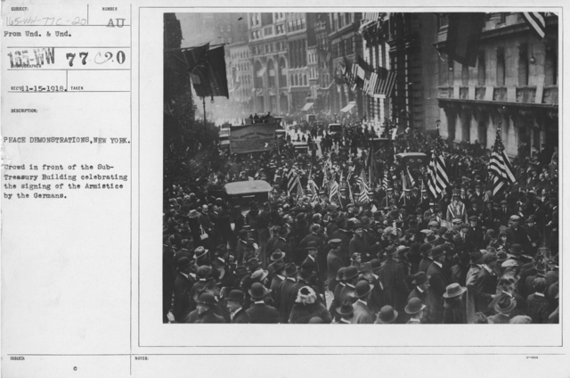Ceremonies - New York City - Peace demonstrations, New York. Crowd in front of the Sub-Treasury Building celebrating the signing of the Armistice by the Germans