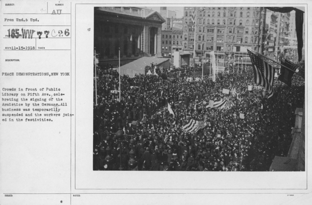 Ceremonies - New York City - Peace demonstrations, New York. Crowds in front of Public Library on Fifth Ave. celebrating the signing of the Armistice by the Germans. All business was temporarily suspended and the workers joined in the festivities