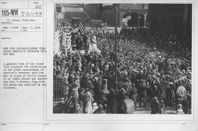 Ceremonies - New York school children celebrate America's entrance into the war. A general view of the crowd that attended the celebration of the first anniversary of America's entrance into the war in front of Public School 43 at 129th Street and Amsterdam Ave. A Service flag with 210 stars was unfurled by the children