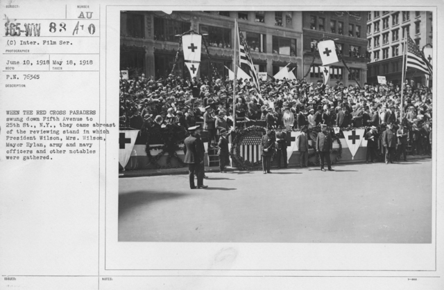 Ceremonies - New York - When the Red Cross paraders swung down Fifth Avenue to 25th St., they came abreast of the reviewing stand in which President Wilson, Mrs. Wilson, Mayor Hylan, army and navy officers and other notables were gathered