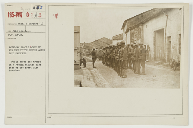 Ceremonies - Review in Theatre of Operations - American Troops - American troops lined by for inspection before going into trenches.  Photo shows the troops in a French village just back of the front line trenches