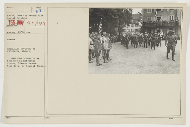 Ceremonies - Review in Theatre of Operations - American Troops - Americans reviewed at Massevaux, Alsace.  American troops being reviewed at Massevaux, Alsace (former German territory) by General Chaise