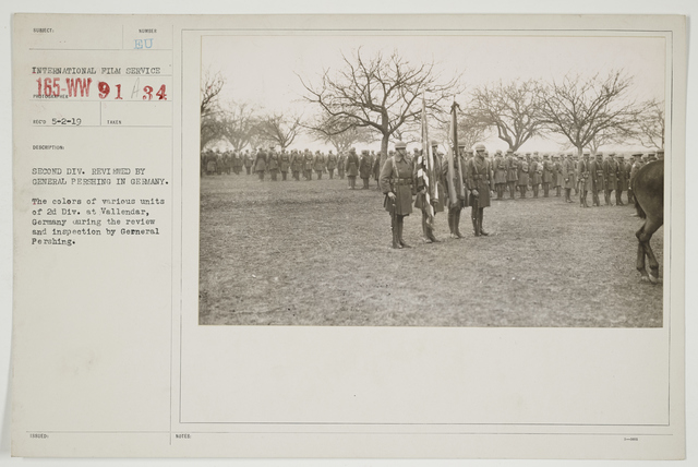 Ceremonies - Review in Theatre of Operations - American Troops - Second Division reviewed by General Pershing in Germany.  The colors of various units of 2d Division at Vallendar, Germany during the review and inspection by General Pershing