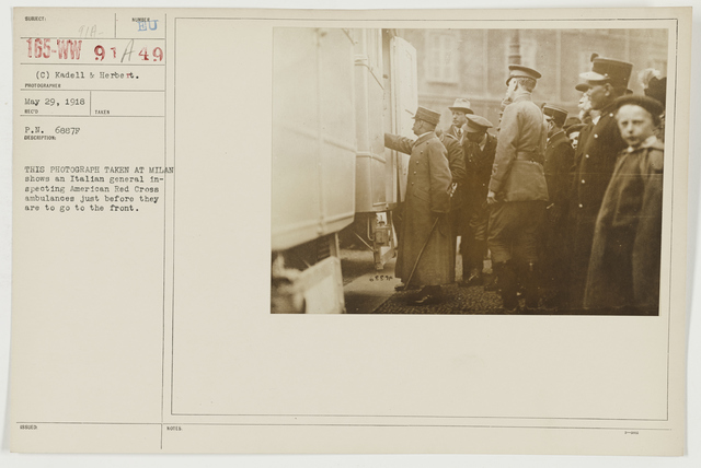 Ceremonies - Review in Theatre of Operations - American Troops - This photograph taken at Milan shows an Italian general inspecting American Red Cross ambulances just before they are to go to the front