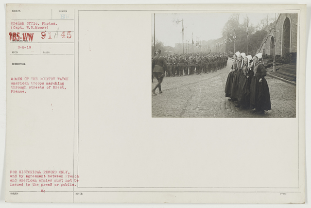 Ceremonies - Review in Theatre of Operations - American Troops - Women of the country watch American troops marching through streets of Brest, France
