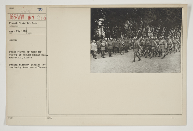 Ceremonies - Review in Theatre of Operations - French Army - First photos of American troops on former German soil.  Massevaux, Alsace.  French regiment passing the reviewing American officers