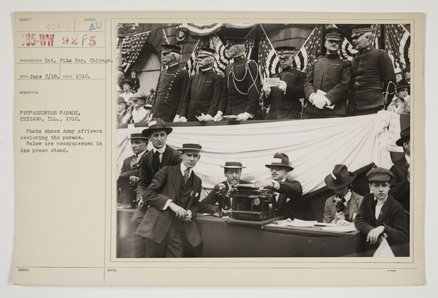 Ceremonies - Salutes and Parades - Illinois - Preparedness Parade, Chicago, Illinois, 1916.  Photo shows Army officers reviewing the parade.  Below are newspapermen in the press stand