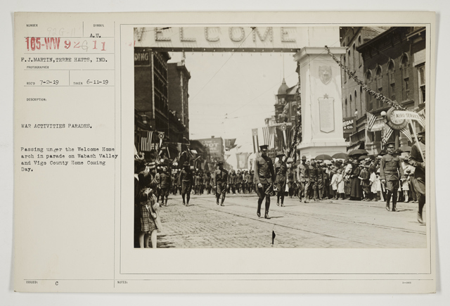 Ceremonies - Salutes and Parades - Indiana - War activates parades.  Passing under the Welcome Home Arch in parade on Wabash Valley and Vige County Home Coming Day