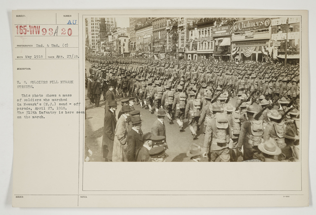 Ceremonies - Salutes and Parades - New Jersey - U.S. Soldiers fill Newark streets.  This photo shows a mass of soldiers who marched in Newark's (New Jersey) send-off parade, April 27, 1918.  The 312th Infantry is here seen on the march