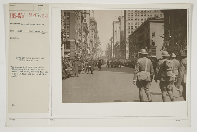 """Ceremonies - Salutes and Parades - New York - 27th Division honored on Victorious Parade.  The famous fighters who broke """"Hindenburg Line"""" march on 5th Avenue, New York, between throngs of people from all parts of the country"""