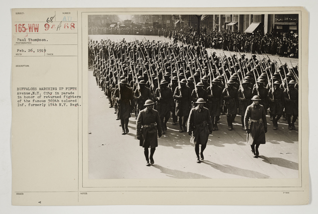 Ceremonies - Salutes and Parades - New York - Buffaloes marching up Fifth Avenue, New York City in parade in honor of returned fighters of the famous 369th colored Infantry Formerly 15th New York Regiment