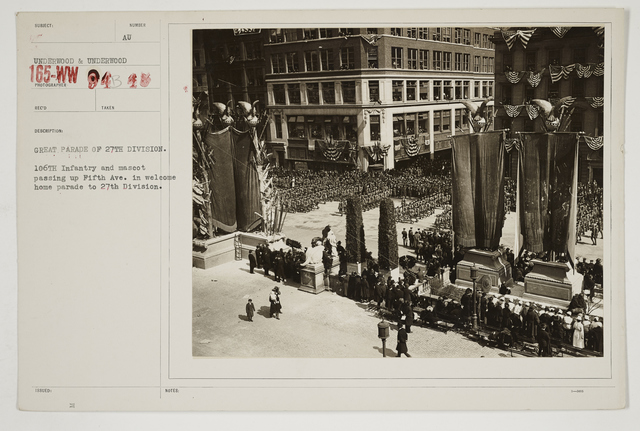 Ceremonies - Salutes and Parades - New York - Great parade of 27th Division.  106th Infantry and mascot passing up Fifth Avenue in welcome home parade to 27th Division