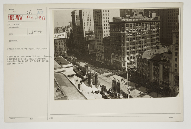 Ceremonies - Salutes and Parades - New York - Great parade of 27th Division.  View from New York Public Library, showing men in 27th Division passing in front of Court of the Honored Dead