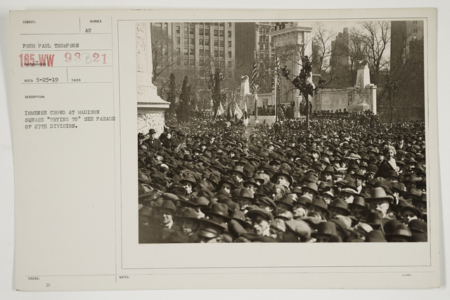"Ceremonies - Salutes and Parades - New York - Immense crowd at Madison Square ""trying to"" see parade of 27th Division"