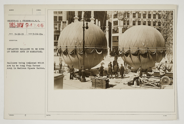 Ceremonies - Salutes and Parades - New York - Inflating balloons to be hung on Heroes Arch in Manhattan.  Balloons being inflated which are to be hung from Heroes Arch in Madison Square Garden