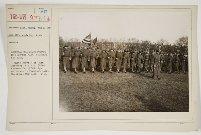 Ceremonies - Salutes and Parades - New York - National Guardsmen parade in Prospect Park, Brooklyn, New York.  Photo shows 47th Regiment Infantry, New York National Guard (53rd Pi1er Infantry, PDCA.  Troops.) on parade in Prospect Park, Brooklyn, New York.  1917