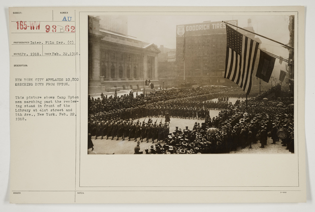 Ceremonies - Salutes and Parades - New York - New York City applauds 10,000 marching boys from Upton.  This picture shows Camp Upton men marching past the reviewing stand in front of the Library at 41st Street and 5th Avenue, New York. February 22, 1918