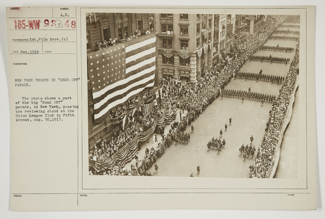 """Ceremonies - Salutes and Parades - New York - New York troops in """"Send Off"""" Parade.  The photo shows a part of the big """"Send Off"""" Parade, in New York, passing the reviewing stand at the Union League Club in Fifth Avenue, August 30, 1917"""