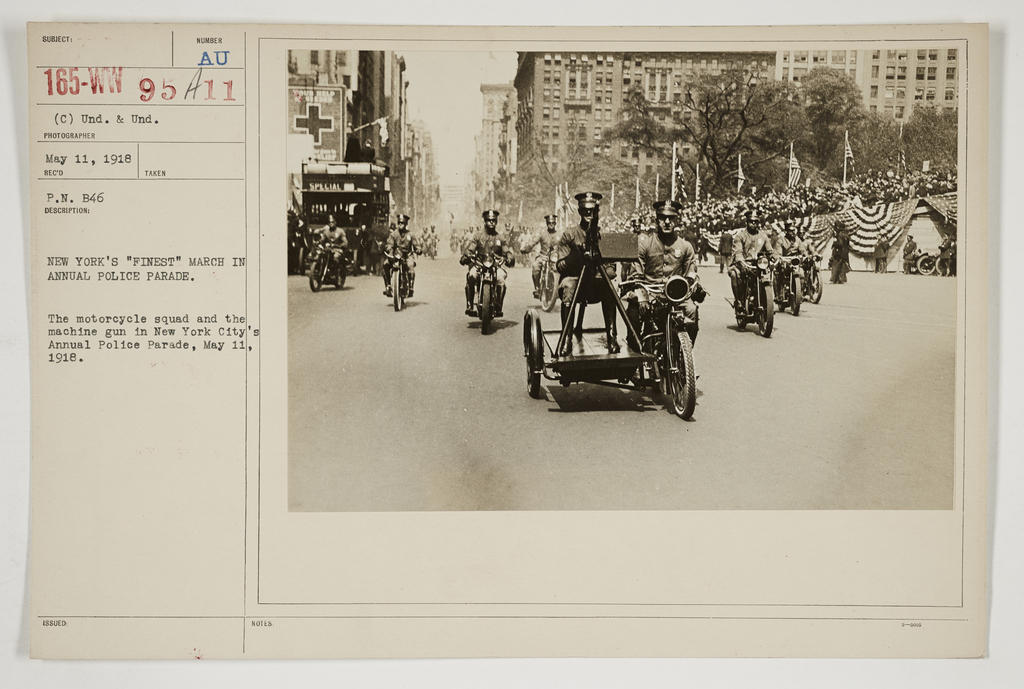 """Ceremonies - Salutes and Parades - New York - New York's """"Finest"""" march in annual Police Parade.  The motorcycle squad and the machine gun in New York City's annual Police Parade, May 11, 1918"""