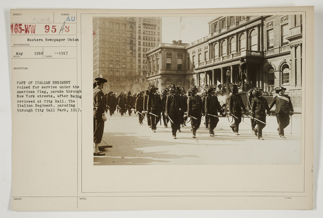 Ceremonies - Salutes and Parades - New York - Part of Italian Regiment raised for service under the American flag, parade through New York streets, after being reviewed at City Hall.  The Italian Regiment, parading through City Hall Park, 1917