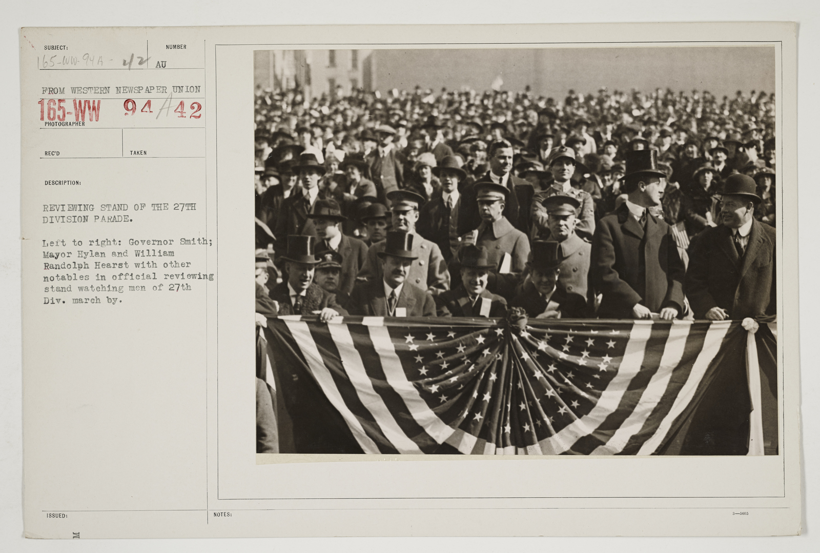 Ceremonies - Salutes and Parades - New York - Reviewing stand of  the 27th Division parade.  Left to right:  Governor Smith; Mayor Hylan and William Randolph Hearst with other notables in official reviewing stand watching men of 27th Division march by
