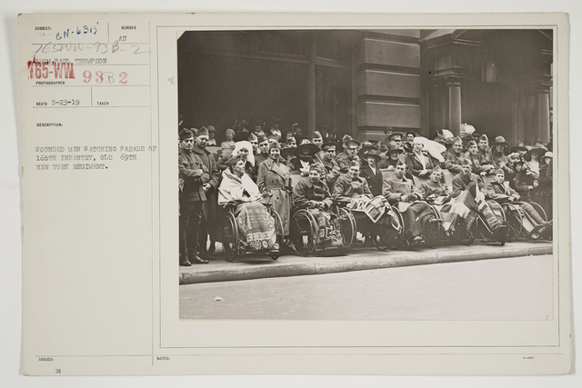 Ceremonies - Salutes and Parades - New York - Wounded men watching parade of 165th Infantry, Old 69th New York Regiment