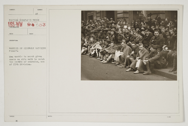 Ceremonies - Salutes and Parades - New York - Wounded on sidewalk watching parade.  Men unable to march given seats on sidewalk to watch the parade of comrades, men of 27th Division