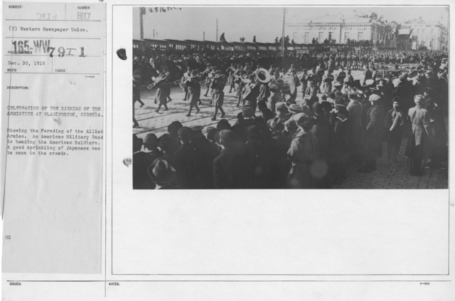 Ceremonies - Siberia - Celebration of the signing of the Armistice at Vladivostok, Siberia. Showing the Parading of the Allied Armies. An American Military Band is heading the American Soldiers. A good sprinkling of Japanese can be seen in the crowds
