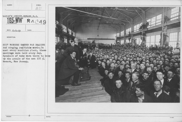 Ceremonies - War Savings Stamps - Ship workers gather for reading and singing patriotic music. In most every munition plant, these meetings were held every day. Speakers of note were there to keep up the morale of the men 100%. Newark, New Jersey