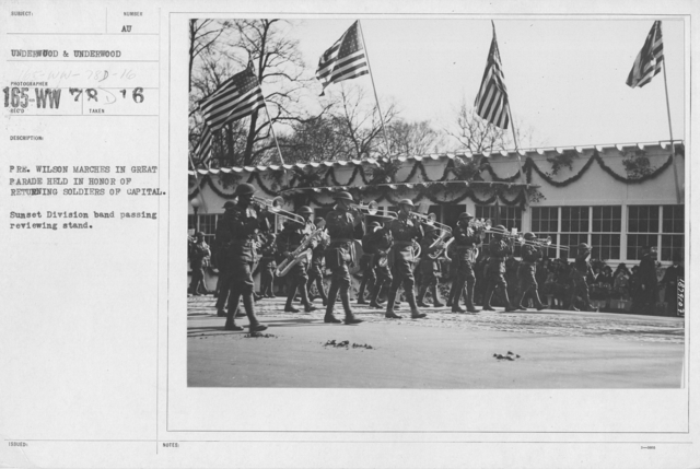 Ceremonies - Washington - Pres. Wilson marches in great parade held in honor of returning soldiers of capitol. Sunset Division band passing reviewing stand