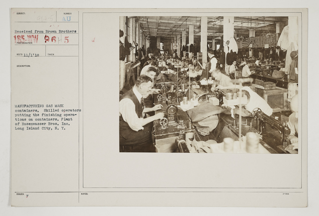 Chemical Warfare Service - Equipment - Manufacturing gas mask containers.  Skilled operators putting the finishing operations on containers.  Plant of Rosenwasser Bros., Inc., Long island City, New York